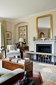 Elegant drawing room with fireplace, fender and rug
