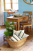 Scatter cushions with DIY covers made from strips of fabric in basket