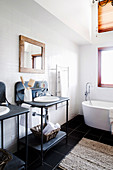 Black and white bathroom with an industrial style vanity