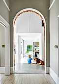 Hallway with arch, toddler with dog