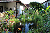 House with garden pond at the terrace