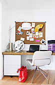 Desk with mobile container, white chair and pin board