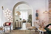 Festively decorated living room with open archway leading into dining room
