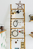 Festively decorated bamboo ladder in kitchen