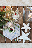 Christmas decorations and hexagonal tile on wooden crate