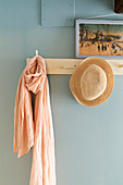 Scarf and hat on coat pegs