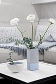 Concrete-effect vase handmade from milk carton