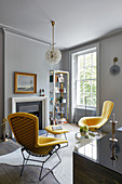 Two modern yellow armchairs in classic living room