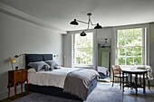 Eclectic bedroom in muted shades