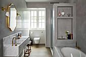 Elegant modern bathroom in shades of grey with marble sink