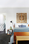 Wooden decoration over double bed in the bedroom