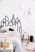 DIY skyline as bed head in the bedroom with pink accents