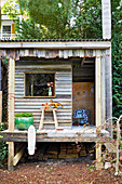 Playhouse made from recycled wood in the garden