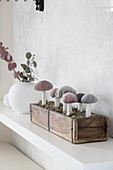 Handcrafted fabric mushrooms with velvet caps in wooden box
