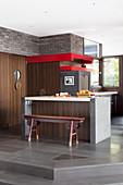 Breakfast counter with antique bench in open kitchen