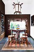 Asian tea room with antique furniture and decorative window frames