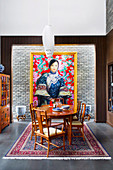 Stylish dining area with antique furniture and an Asian image