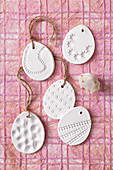 Modelling clay eggs embossed with various patterns