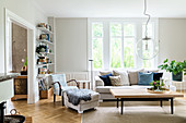 Eclectic mixture of furniture in bright, Scandinavian-style living room