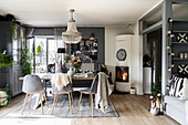 Fireplace in dining area of open-plan interior in shades of grey