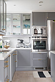 L-shaped fitted kitchen with pale grey cabinets