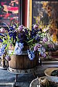 Spring flowers in wooden tub on desk
