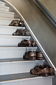 Old men's shoes on stair treads