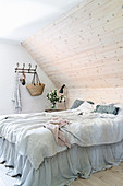 Bed with valance against wood-clad knee wall