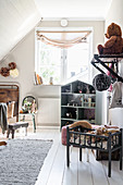 Vintage-style nursery under sloping ceiling