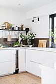 Dark wooden splashback in white kitchen