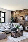 Wall clad in dark wood in rustic living room