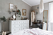 Bohemian-style bedroom with grey walls