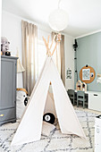 Play tent on diamond-patterned rug in children's bedroom