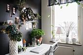 Plants on desk against black wall