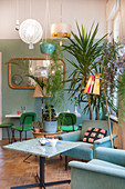 Retro-style cafe in shop decorated with houseplants and lamps