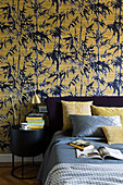 Yellow and blue bamboo-patterned wallpaper in bedroom