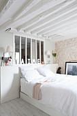 Interior window in bright, Mediterranean bedroom