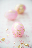 Pink eggs with gold leaf