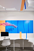 Graphic design on desk and wall in office with cloud-shaped suspended ceiling at HARU Gallery, London, United Kingdom