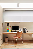 Desk and wall cabinet in home office