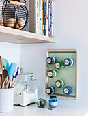 Spice rack made from tiny jars and baking tray