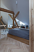 Wooden double bed in attic bedroom