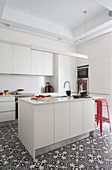 Island counter in white fitted kitchen