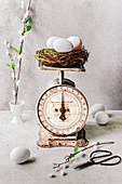 A vintage kitchen scale with an Easter basket