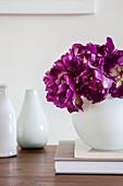 'Purple peony' tulips in white spherical vase