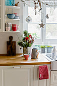 Christmas decorations in country-house kitchen