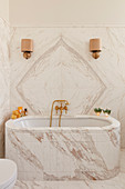Luxurious bathroom with marble walls and bathtub