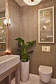 Modern bathroom in shades of grey with rectangular marble sink