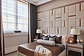 Elaborately upholstered wall in elegant bedroom
