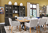 Upholstered chairs and dresser in dining area
